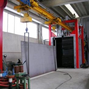 Granigliatrice-a-tunnel-passante-con-linea-di-trasporto-aerea